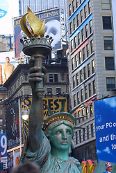 A Statue of Liberty balloon takes part in the 75th Macy's Thanksgiving Day Parade passing through Times Square, November 2001.