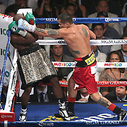 LAS VEGAS, NV - SEPTEMBER 13: Marcos Maidana (R) lands a blow to the head of Floyd Mayweather Jr. during their WBC/WBA welterweight title fight at the MGM Grand Garden Arena on September 13, 2014 in Las Vegas, Nevada. (Photo by Alex Menendez/Getty Images) *** Local Caption *** Floyd Mayweather Jr; Marcos Maidana