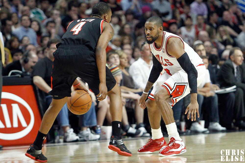 16 March 2012: Chicago Bulls point guard C.J. Watson (7) defends on Portland Trail Blazers guard Nolan Smith (4) during the Portland Trail Blazers 100-89 victory over the Chicago Bulls at the United Center, Chicago, Illinois, USA.