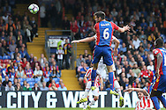 Scott Dann of Crystal Palace heads the ball from a corner. Premier League match, Crystal Palace v Stoke city at Selhurst Park in London on Sunday 18th Sept 2016. pic by John Patrick Fletcher, Andrew Orchard sports photography.