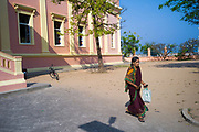 A woman leaves the Notre Dame des Anges church, Pondicherry, India. Built in the 1850s the church is in the  French Quarter of the town and looks out towards the Indian Ocean
