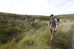 Defence Forces personnel carry out a search near the Wicklow Way in the Wicklow Mountains after human remains believed to be from a murdered young man were found in the area.