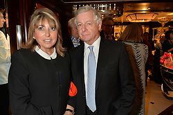 SIR NICHOLAS LLOYD and EVE POLLARD (Lady Lloyd) at a party to celebrate the publication of 'A Designer's Life' by Nicky Haslam held at Ralph Lauren, 1 New Bond Street, London on 19th November 2014.