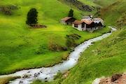 A river runs through the alps in Switzerland .