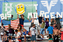"""Fans with sign """"Bis morgen"""" at A1 Beach Volleyball Grand Slam tournament of Swatch FIVB World Tour 2010, on July 31, 2010 in Klagenfurt, Austria. (Photo by Matic Klansek Velej / Sportida)"""