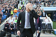 Burnley manager Sean Dyche holds his head in his hand during the Sky Bet Championship match between Brighton and Hove Albion and Burnley at the American Express Community Stadium, Brighton and Hove, England on 2 April 2016.