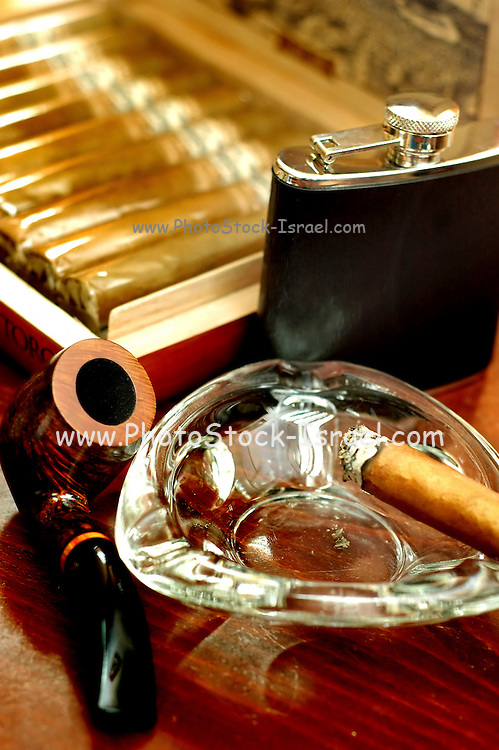 still life, Old wooden pipe, cigars and a flask of single malt highlands scotch whiskey