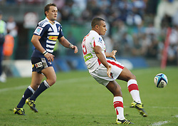 Man of the Match Will Genia of the Reds chips the ball with opposite number Dewaldt Duvenhage looking on during the Super Rugby (Super 15) fixture between DHL Stormers and the Reds played at DHL Newlands in Cape Town, South Africa on 9 April 2011. Photo by Jacques Rossouw/SPORTZPICS