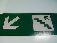 a graphic sign on a Washington State DOT ferry pointing to an up ladder (stairway) Puget Sound, Washington, USA