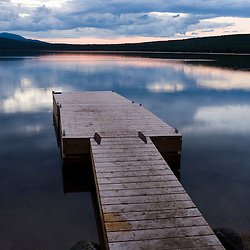 The boat dock on Katahdin Lake in Maine's Baxter State Park.  Katahdin Lake Widlerness Camps.  Dusk.