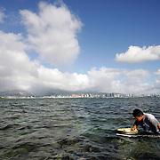 HONOLULU, HAWAII, November 8, 2007: Tadd Fujikawa, a sixteen-year-old professional golfer, hunts for octopus on a reef in Honolulu, Hawaii.