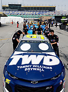 NASCAR race crews and their cars wait in line for an inspection before a practice run at Kansas Speedway in Kansas City, Kan., Saturday, May 11, 2018. (AP Photo/Colin E. Braley)