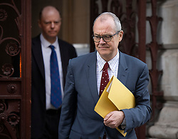 © Licensed to London News Pictures. 15/12/2020. London, UK. Chief Scientific Adviser Sir Patrick Vallance (R) walks from the Foreign Office with Chief Medical Officer for England Professor Chris Whitty after attending a Cabinet meeting. London and other areas of the south east are to enter Tier Three restrictions at midnight tonight as Covid-19 infection rates rise. Photo credit: Peter Macdiarmid/LNP