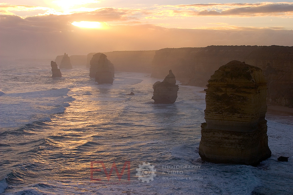 Twelve Apostles with hazy sunset, Western Victorian Coast, Australia.<br /> <br /> Larger JPEG + TIFF images available by contacting use through our contact page at :..www.photography4business.com