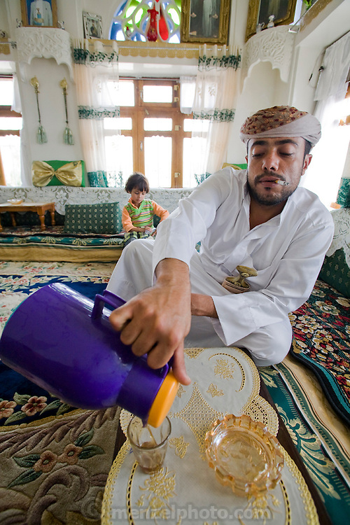 Traditional knife seller Bashir Sabana pours himself a glass of tea while smoking a cigarette at his home in Sanaa, Yemen.   (Bashir Sabana is one of the people interviewed for the book What I Eat: Around the World in 80 Diets.)