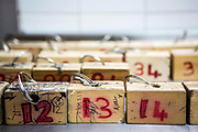 Numbered locker key blocks from the prison family visit centre.  HMP/YOI Portland, a resettlement prison with a capacity for 530 prisoners.
