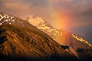 Rainbow at sunrise. Glentanner Park Centre Mount Cook, in the Southern Alps, Canterbury region, South Island, New Zealand.