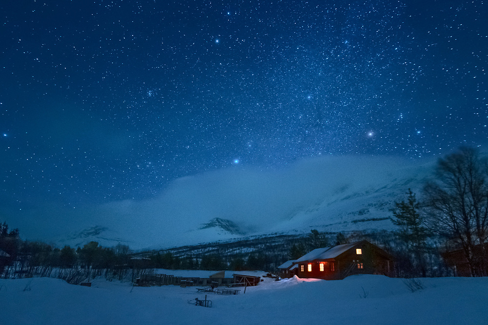 Norway's geography makes it possible to observe clear skies almost every night. For instance, the evening this image was taken, it rained in Tromsø for hours. But after driving inland for less than an hour, we felt the temperature dropping and saw the skies opening up.