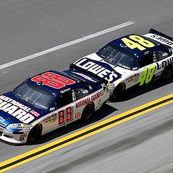 April 17, 2011; Talladega, AL, USA; NASCAR Sprint Cup Series driver Jimmie Johnson (48) bump drafts with Dale Earnhardt Jr. (88) during the Aarons 499 at Talladega Superspeedway.   Mandatory Credit: Derick E. Hingle
