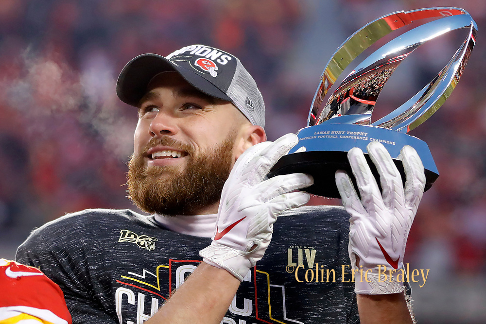 Kansas City Chiefs tight end Travis Kelce holds the Lamar Hunt Trophy after winning an NFL, AFC Championship football game against the Tennessee Titans, Sunday, Jan. 19, 2020, in Kansas City, MO. The Chiefs won 35-24 to advance to Super Bowl 54. Photo by Colin Eric Braley Photography Colin Eric Braley Photography