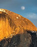 Full moon rising over the shoulder of Half Dome, Yosemite Valley,Yosemite National Park, California