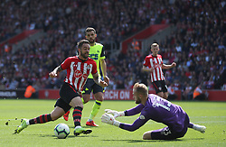 Southampton's Danny Ings is stopped by Huddersfield Town's goalkeeper Joel Coleman during the Premier League match at St Mary's Stadium, Southampton.