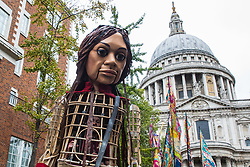 Little Amal, a giant puppet of a Syrian refugee girl fleeing conflict, walks from St Paul's Cathedral to the Globe Theatre on 23rd October 2021 in London, United Kingdom. The 3.5-metre puppet, which is nearing the end of an 8,000km journey from the Turkish-Syrian border to Manchester in support of refugees, climbed the steps of St Paul's Cathedral to present a wood carving of a ship at sea from St Paul's birthplace at Tarsus in Turkey to the dean.