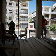 August 10, 2012 - Aleppo, Syria: A group of Free Syria Army (FSA) fighters aim at a Syrian Army snipper during an advance towards the frontline in Saheledine, a strategic neighborhood in southwest Aleppo...The Syrian Army have in the past week increased their attacks on residential neighborhoods where Free Syria Army rebel fights have their positions in Syria's commercial capital, Aleppo.