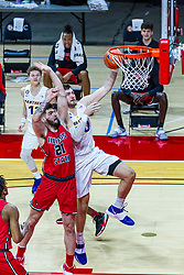 NORMAL, IL - February 27: Austin Phyfe works his way to the hoop passing Dusan Mahorcic during a college basketball game between the ISU Redbirds and the Northern Iowa Panthers on February 27 2021 at Redbird Arena in Normal, IL. (Photo by Alan Look)