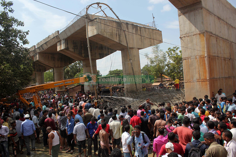 September 10, 2017 - Bhubaneswar, Odisha, India - ODRF (Odisha Disaster Response Force) and fire fighters look near the under construction bridge collapse area as they are busy in the rescue works from the debris of collapsed bridge in the eastern state Odisha's capital city Bhubaneswar on 9 September 2017. One dead and above many labourers is seriously injured and till now some of them under the debris in this mishap. (Credit Image: © Str/NurPhoto via ZUMA Press)