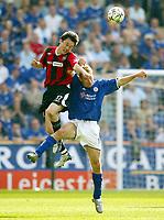 Photo: Scott Heavey.<br />Leicester City v Manchester City. FA Barclaycard Premiership. 24/04/2004.<br />Sun Jihai beats James Scowcroft in the air
