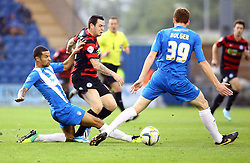 Peterborough United's Lee Tomlin in action with Colchester United's Craig Eastmond and Colchester United's Cian Bolger - Photo mandatory by-line: Joe Dent/JMP - Tel: Mobile: 07966 386802 26/10/2013 - SPORT - FOOTBALL - Colchester Community Stadium - Colchester - Colchester United v Peterborough United - Sky Bet League One