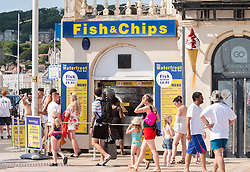 © Licensed to London News Pictures;30/05/2020; Weston-super-Mare UK. People visit food and gift shops in hot sunny weather on the beach and promenade at the seaside in Weston-super-Mare, on the last weekend before some more restrictions under the coronavirus lockdown are to be eased by the Government. From Monday groups of up to 6 people from different households will be able to meet outside but must maintain social distancing to prevent the spread of the Covid-19 virus. There has been an outbreak of Covid-19 at Weston General Hospital which has now been traced to an accommodation block inside the hospital grounds. The outbreak had been blamed on visitors to Weston coming from outside the area. Photo credit: Simon Chapman/LNP.