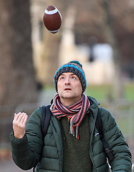 © Licensed to London News Pictures. 09/12/2019. London, UK. DOMINIC CUMMINGS, special adviser to the government of Boris Johnson, is seen playing with a small American football as he leaves 10 Downing Street in London, days ahead of a general election which is due to take place on Thursday. Photo credit: Ben Cawthra/LNP
