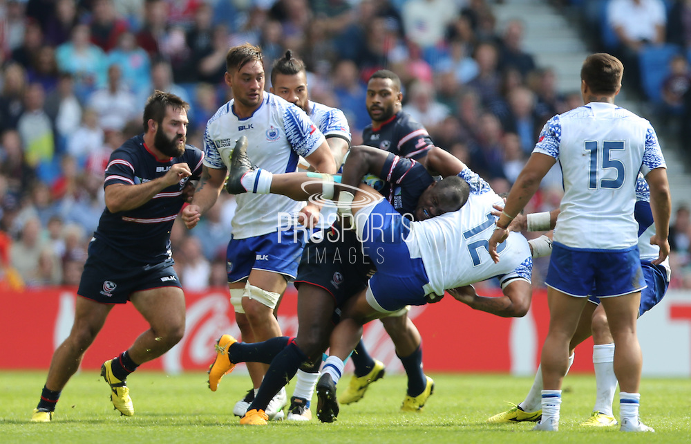 USA Takudzwa Ngwenya and Samoa Rey Lee-Lo tackle during the Rugby World Cup 2015 match between Samoa and USA at the Brighton Community Stadium, Falmer, United Kingdom on 20 September 2015.