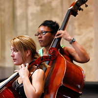"Central America, Cuba, Havana. Cellists of Cuban Orchestra ""Camerata Romeu"" rehearses in Basilica Menor de San Francisco de Asis."