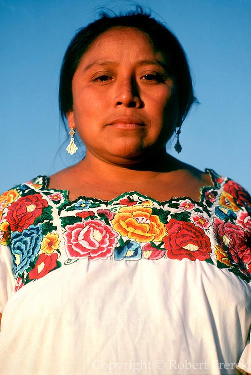 MEXICO, YUCATAN Mayan family near Chichen Itza, portrait of mother