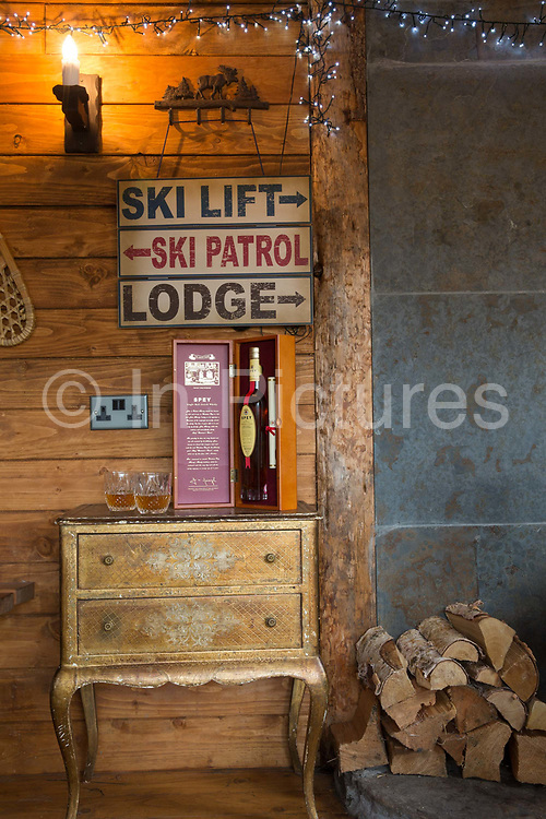 A wooden cabin with log burner and bottle of whiskey on the 7th November 2018 in Aviemore, Scotland in the United Kingdom.