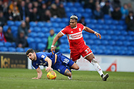 Callum Paterson of Cardiff city (l) falls under a challenge from Adama Traore of Middlesbrough. EFL Skybet championship match, Cardiff city v Middlesbrough at the Cardiff city Stadium in Cardiff, South Wales on Saturday 17th February 2018.<br /> pic by Andrew Orchard, Andrew Orchard sports photography.
