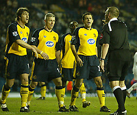 Photo: Aidan Ellis.<br /> Leeds United v Wigan Athletic. The FA Cup. 17/01/2006.<br /> Wigan's Arjun De Zeuw, Graham Kavanagh and Josip Skoko protest to Referee Graham Poll after he gives a penalty