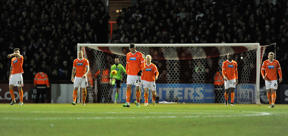 Blackpool players dejected after conceding the 4th goal to Brentford<br /> <br /> Photographer Ashley Western/CameraSport<br /> <br /> Football - The Football League Sky Bet League One - Brentford v Blackpool - Tuesday 24th February 2015 - Griffin Park - London<br /> <br /> © CameraSport - 43 Linden Ave. Countesthorpe. Leicester. England. LE8 5PG - Tel: +44 (0) 116 277 4147 - admin@camerasport.com - www.camerasport.com