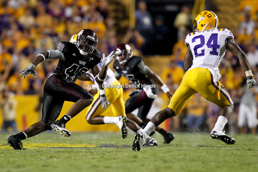 Sep 18, 2010; Baton Rouge, LA, USA; Mississippi State Bulldogs linebacker Emmanuel Gatling (48) covers LSU Tigers running back Alfred Blue (24) during the second half at Tiger Stadium. The LSU Tigers defeated the Mississippi State Bulldogs 29-7. Mandatory Credit: Derick E. Hingle