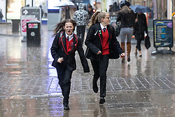 © Licensed to London News Pictures. 25/04/2019. Manchester, UK. People dash for cover in Piccadilly as a sudden thunderstorm brings hail, thunder and lightening over Manchester City Centre . Photo credit: Joel Goodman/LNP