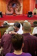 Een man ondergaat de darshan, oftewel omhelzing van Amma. In de Expo in Houten is Mata Amritanandamayi, beter bekend als Amma of 'hugging mother', aanwezig om mensen te omhelzen en te inspireren. Het driedaags benefiet in Houten is het grootste spirituele festival in Nederland en zal naar verwachting 15.000 bezoekers trekken.<br /> <br /> A visitor is receiving the darshan from Amma. In the Expo in Houten people are gathering to get a darshan, or hug, by  Mata Amritanandamayi, also known as Amma or 'hugging mother'. Amma is travelling through the world to hug people for inspiring them to make a better world. Amma is one of the twelve most influence spiritual leaders of the world. The event in Houten lasts for three days and is the biggest spiritual event of The Netherlands.