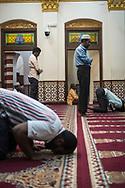 Muslim men pray inside the Jami Ul-Alfar Mosque in Colombo, Sri Lanka (March 31, 2017)