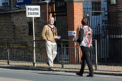 © Licensed to London News Pictures. 11/06/2015. London, UK. Political canvassers outside a polling station in Stepney, Tower Hamlets, east London. Tower Hamlets residents go to the polls today to vote for a new Mayor of Tower Hamlets after Lutfur Rahman was removed from office for fraud in corrupt practices by an election court earlier this year. Photo credit : Vickie Flores/LNP