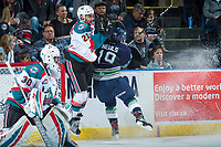 KELOWNA, CANADA - APRIL 25: Donovan Neuls #19 of the Seattle Thunderbirds checks Devante Stephens #21 into the board behind the net of \h30-\ on April 25, 2017 at Prospera Place in Kelowna, British Columbia, Canada.  (Photo by Marissa Baecker/Shoot the Breeze)  *** Local Caption ***