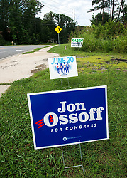 June 19, 2017 - Sandy Springs, Georgia, U.S. -  Campaign signs for Democratic candidate Jon Ossoff and Republican candidate Karen Handel compete for drivers' attention on the eve of the June 20 special election for Georgia's Sixth Congressional District seat.(Credit Image: © Brian Cahn via ZUMA Wire)