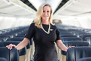 Southwest Airlines flight attendant Marty Cobb poses for a portrait at Love Field in Dallas, Texas on May 20, 2016. (Cooper Neill for The New York Times)