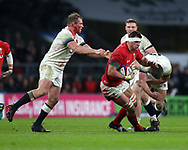 Aaron Shingler of Wales © tries to go past England's Dylan Hartley (l) and Owen Farrell ® . England v Wales, NatWest 6 nations 2018 championship match at Twickenham Stadium in Middlesex, England on Saturday 10th February 2018.<br /> pic by Andrew Orchard, Andrew Orchard sports photography